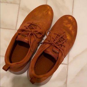 Burnt orange metallic Nike Roshe shoes